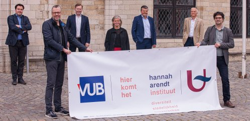 All members of the Hannah Arendt Instituut with a banner in front of the Mechelen city hall